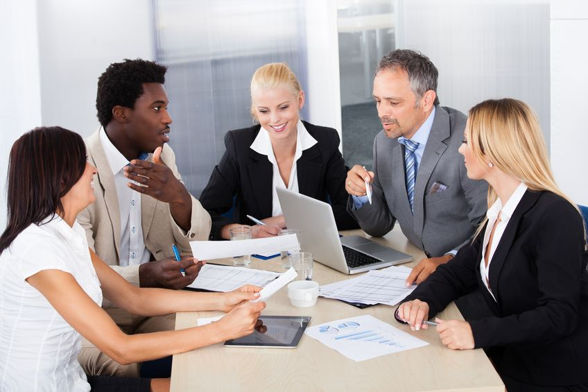 21477389 - group of multi ethnic businesspeople discussing together in office