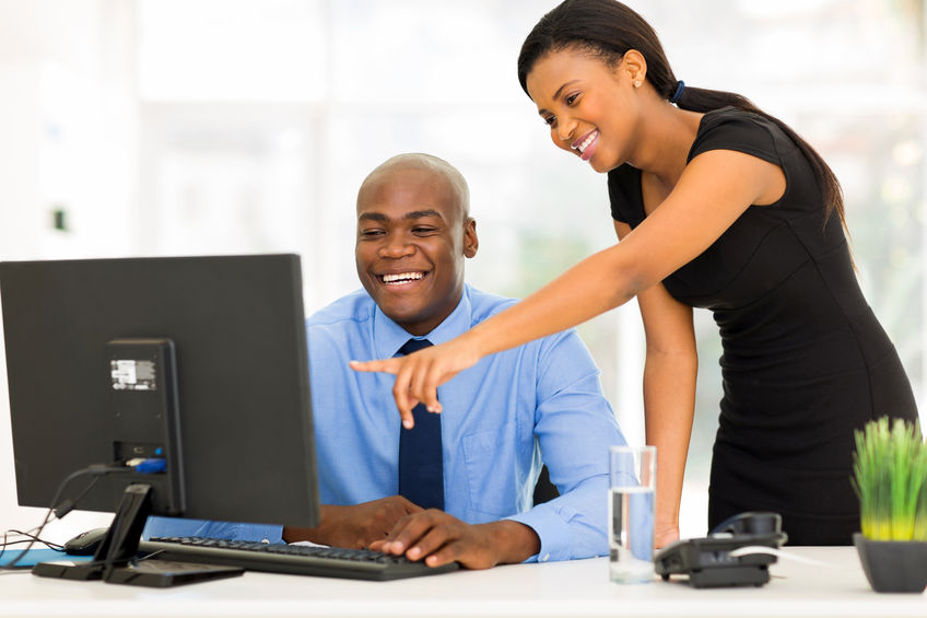 32519144 - african businesspeople working at the office on a computer