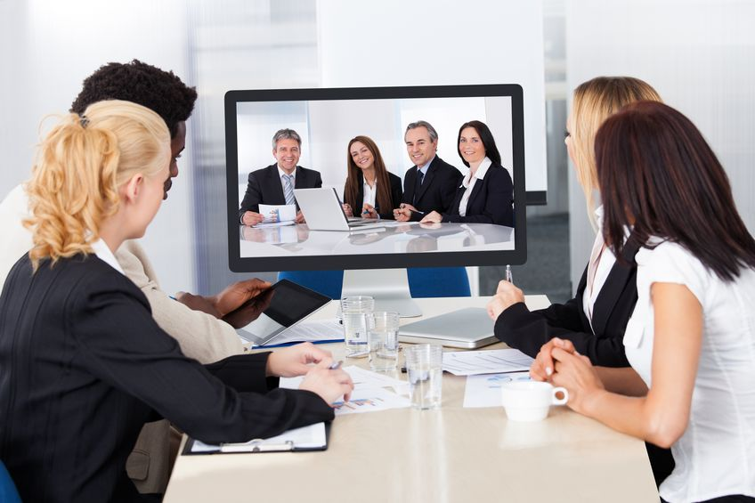 21668233 - group of male and female businesspeople at video conference